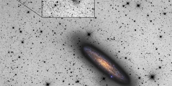 Спиралевидная галактика поглощает карликовую